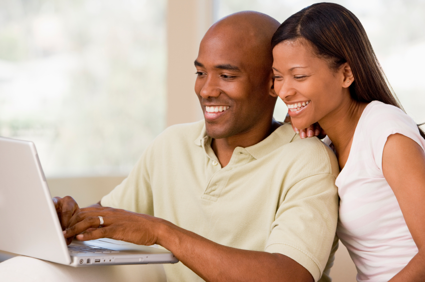 happy couple checking credit online