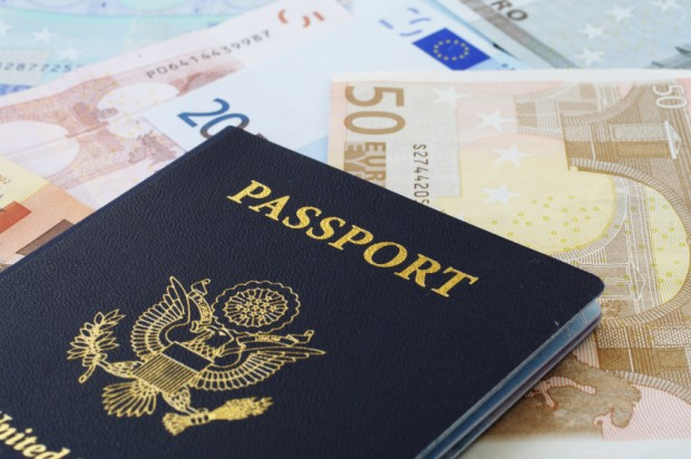 passport and international currency