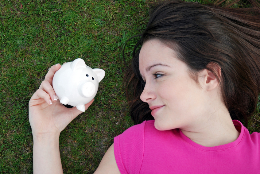 teenager with piggy bank