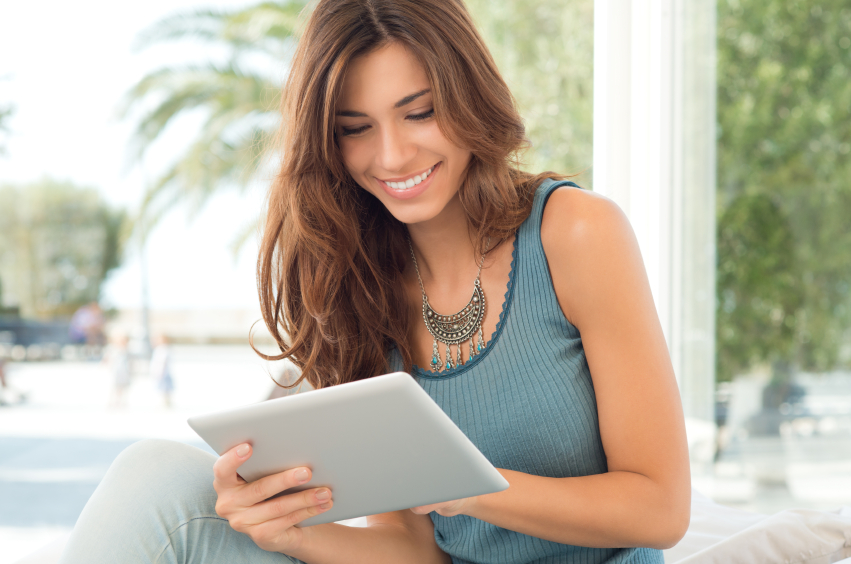 woman reviewing accounts on tablet