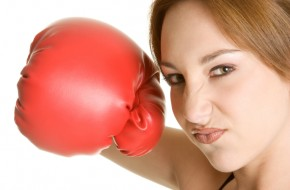 woman with boxing glove ready to battle