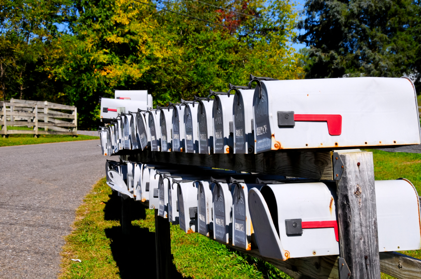 row of unlocked mailboxes
