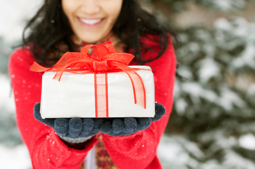 Woman Holding Wrapped Christmas Gift