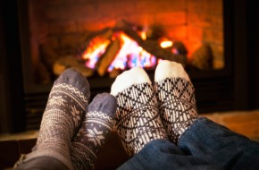 warm in front of cozy winter fire