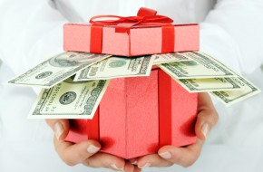 christmas giftbox filled with cash
