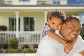 Father with son in front of home